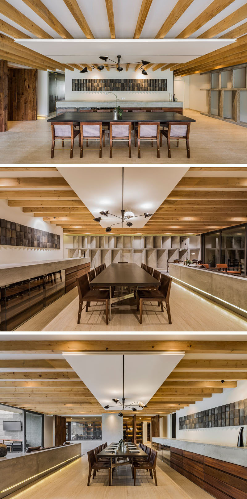 Separated from the living room by a concrete pony wall with embedded lighting, is the main dining area of this modern apartment. A large table fills the open space, while a custom-built concrete and wood sideboard runs alongside it. #DiningRoom #PonyWall #ModernApartment