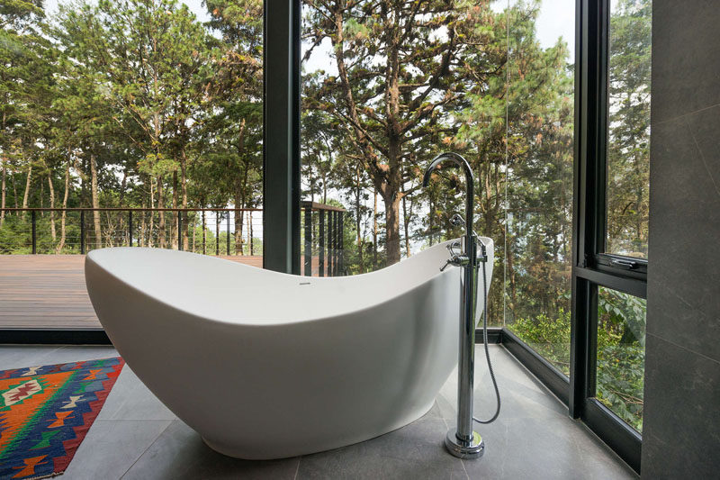 This freestanding bathtub is positioned to take advantage of the tree views. #Bathroom #FreestandingBathtub