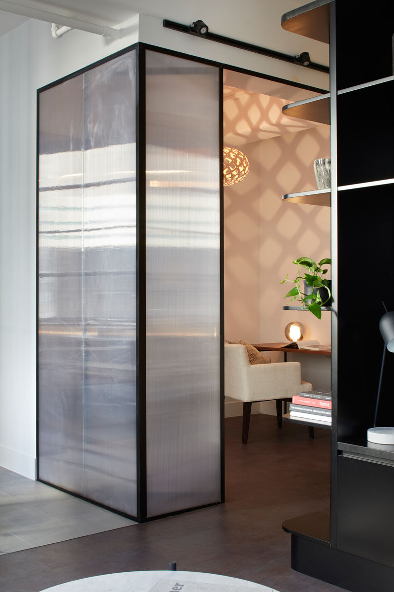 This small and modern home officefeatures polycarbonate sheeting that allowed the designers to enclose internal spaces but still let in some light from the main living areas. #HomeOffice #Walls #InteriorDesign