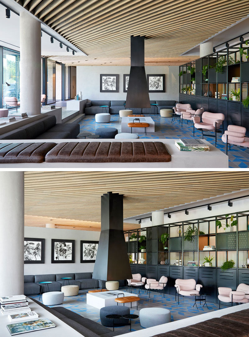 This modern hotel has a lobby with a central fireplace surrounded by couches and comfortable seating. #HotelLobby #HotelLounge #Fireplace