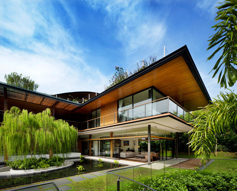 Guz Architects have designed the 'Ficus House', a modern residence in Singapore, that's been designed for a large family consisting of siblings, their families, and a parent. #Architecture #ModernHouse #Landscaping #LandscapeDesign