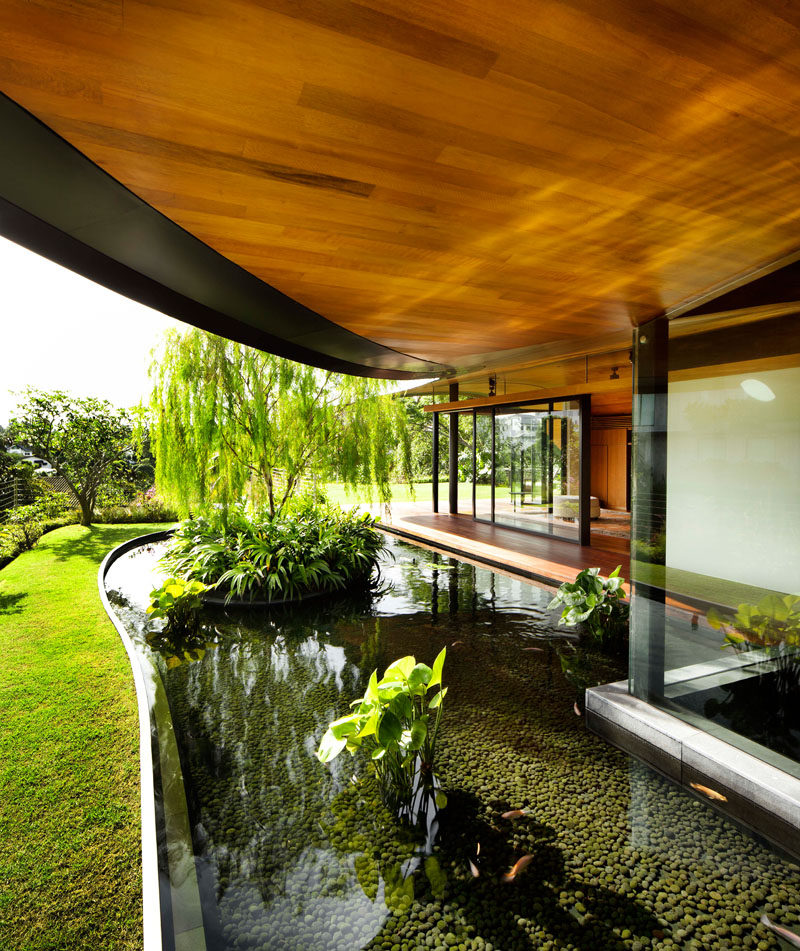 To maximize the indoor/outdoor experience, there's plenty of landscaped areas with grassy lawns, stone pavers, and water features surrounding this modern house. #Landscaping #WaterFeature #ModernHouse