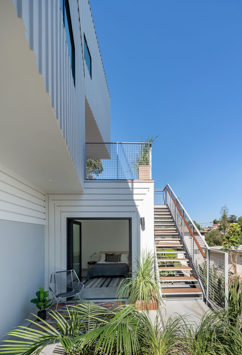 This modern four storey house has an accessory dwelling unit (ADU) that's incorporated into the house on the second level, between the garage and the upper levels. #Architecture #OutdoorSpace #ExteriorStairs
