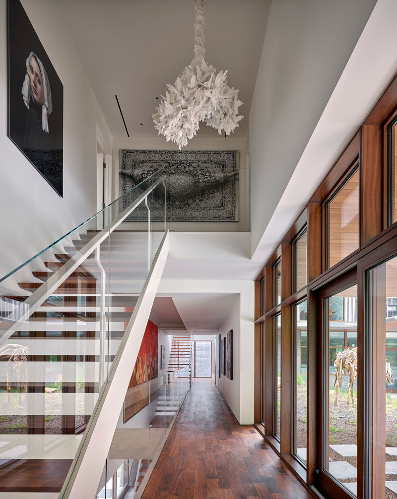 Multiple sets of stairs connect the various floors of this modern house. #Stairs #Hallway