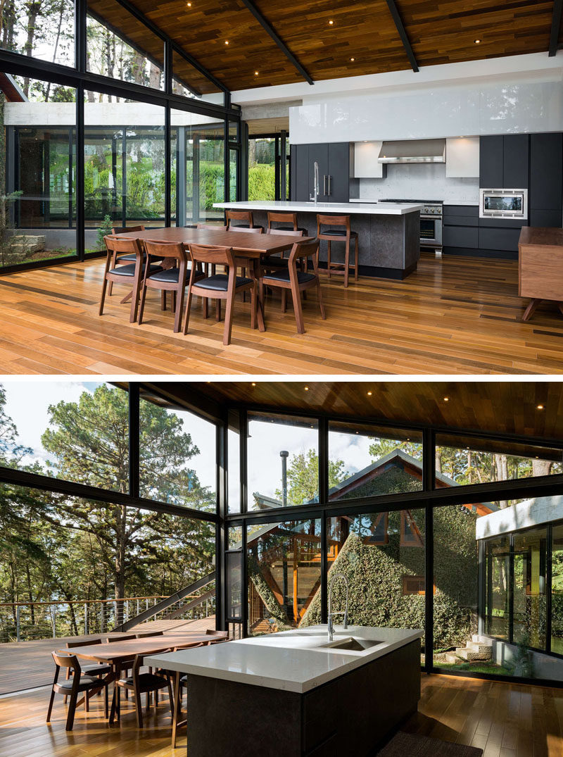 This modern house has plenty of windows that add natural light to the kitchen and dining room. #KitchenDesign #DiningTable