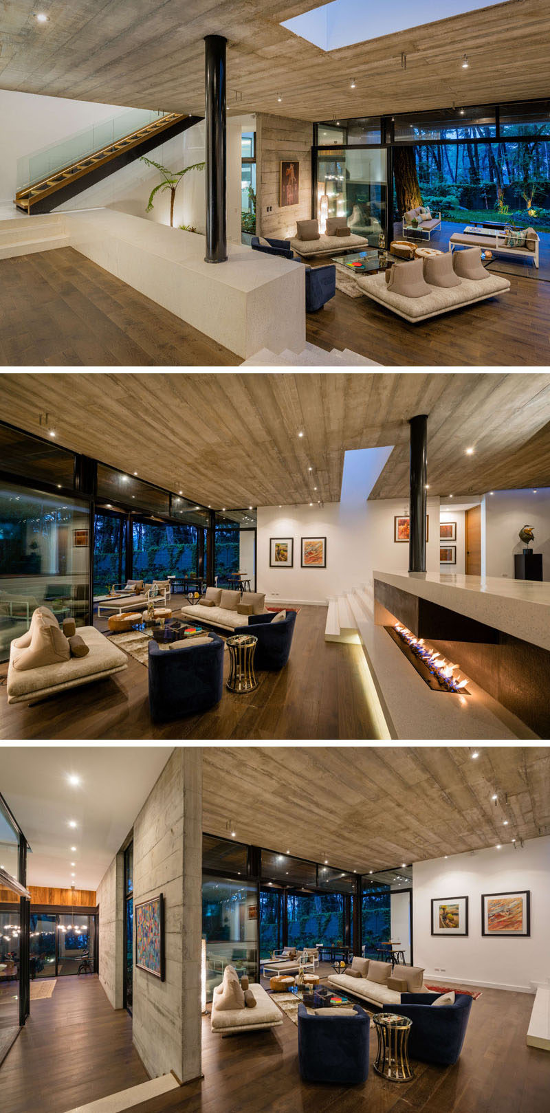 This modern living room has a fireplace for added warmth, a skylight to add natural light, and large sliding doors that open to the outside. #LivingRoom #Fireplace #ConcreteCeiling #WoodFloors