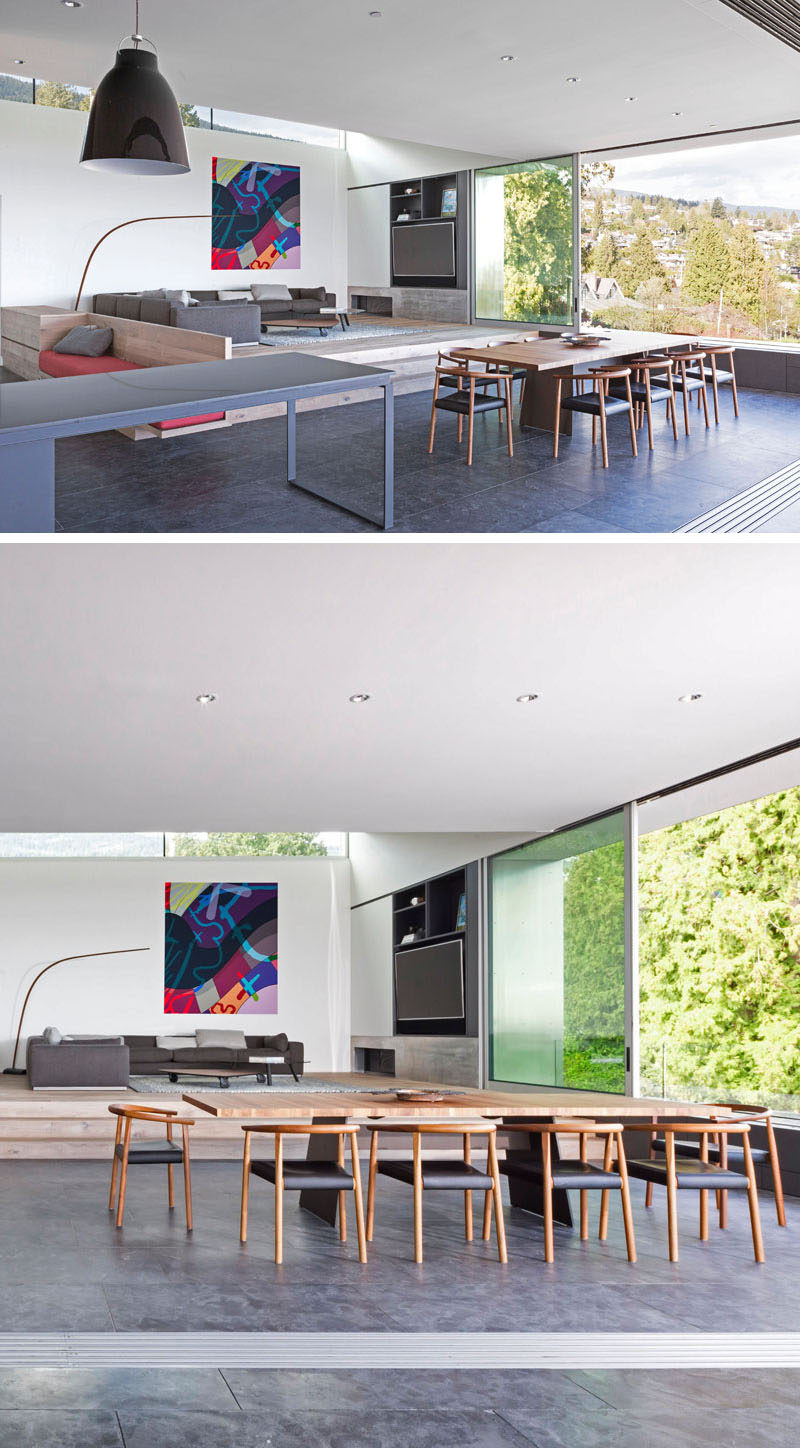 The living room of this modern house is positioned behind and slightly above the dining room to allow it to view over and past furniture in front. #OpenPlan #RaisedLivingRoom #InteriorDesign #DiningRoom