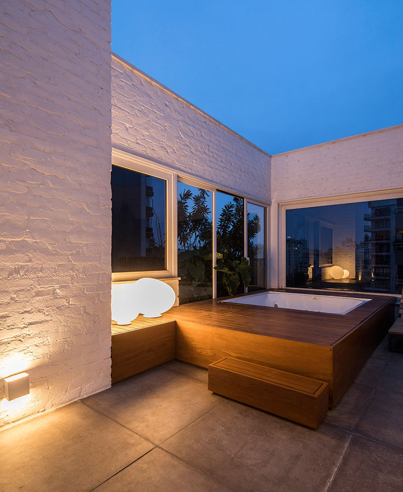 This apartment terrace has a hot tub with a wood surround. #Hottub #Spa