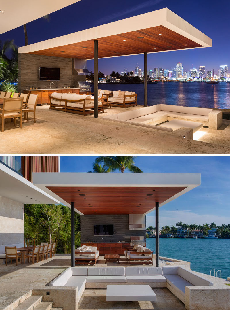 This modern outdoor space has a sunken outdoor living room that sits beneath the level of the pool, and is located between the pool and the outdoor summer kitchen and dining area. #Cabana #SunkenLounge #SunkenOutdoorLounge #OutdoorKitchen