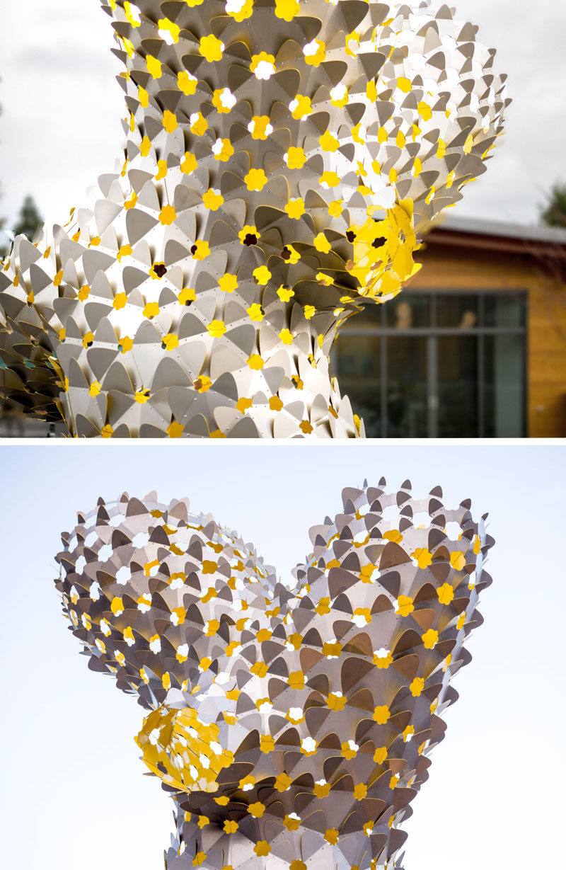 Artist Rob Ley has created a modern sculpture made from hundreds of stainless steel bow-tie shaped elements. #PublicArt #Sculpture #Design