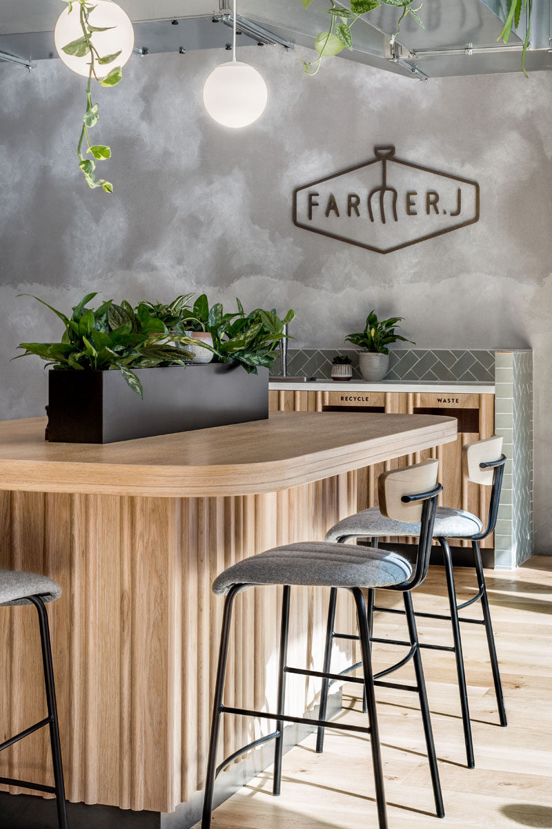 This modern restaurant has a lighter material palette enticing customers to the casual and relaxing interior. #RestaurantInterior #RestaurantDesign