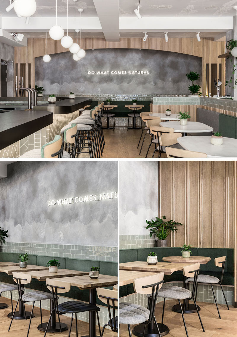 This modern restaurant uses a soft neutral palette with hints of green that complements the rendered concrete walls. #RestaurantDesign #Restaurant