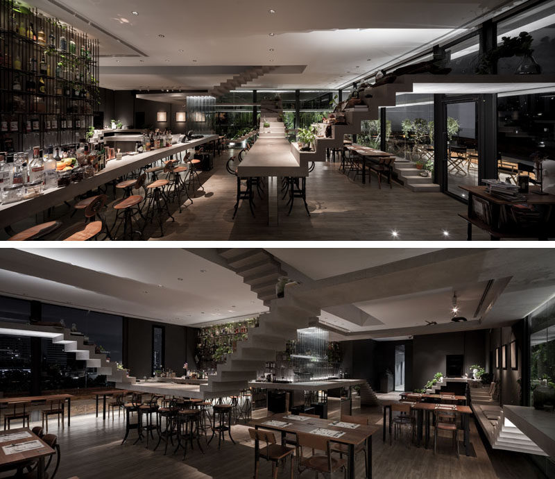 This modern restaurant uses loops of concrete stairs to create different functions throughout its design, like seats, tables,a bar, and communal areas. #RestaurantDesign #BarDesign #Stairs #ConcreteStairs