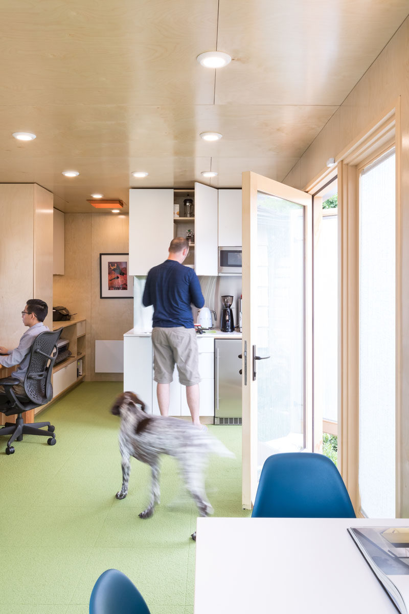 This shipping container office contains a kitchenette, washroom, printer / network cabinet and an open studio space. #HoemOffice #ShippingContainerOffice #OfficeDesign