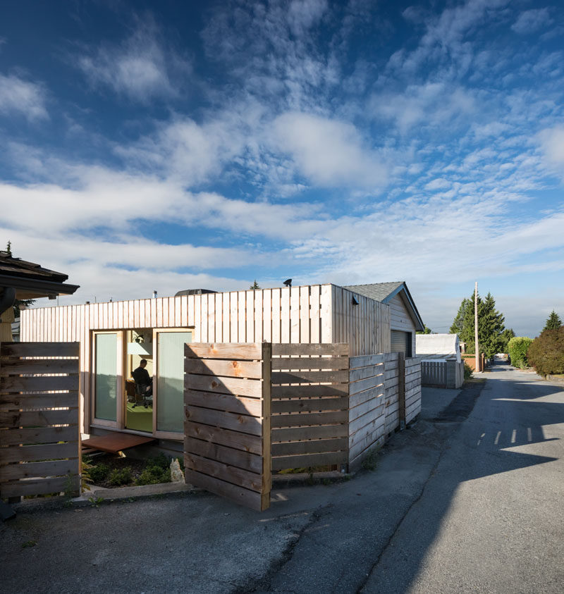 A cedar clad shipping container office sits quietly in this residential neighborhood. #ShippingContainerOffice #Achitecture