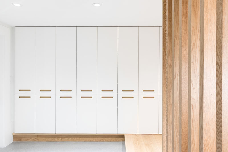 This modern house has a storage area that's filled with white floor-to-ceiling cabinetry. #Storage #Cabinets
