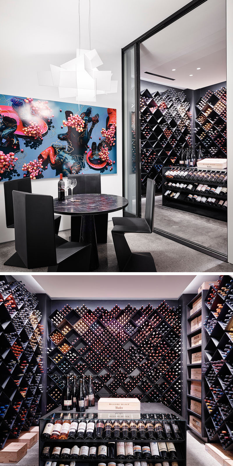 This modern wine cellar has a sliding glass door that opens to an extensive wine collection that's housed within diamond-shaped shelving, while an island provides a place to display selected bottles. #WineCellar #ModernWineCellar #WineStorage