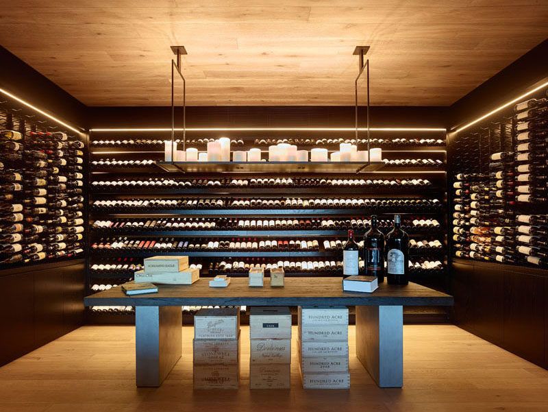 This modern house has a dedicated wine cellar with a table and plenty of storage. #WineCellar #WineStorage