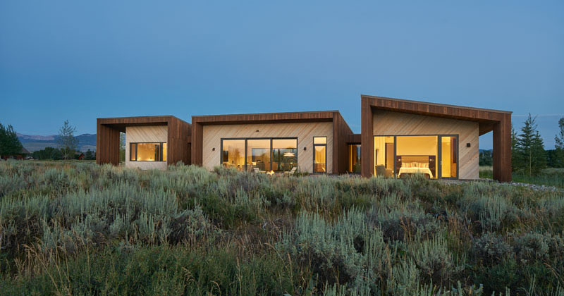 This House In Wyoming Uses Dark And Light Wood To Create A Two-Toned Facade