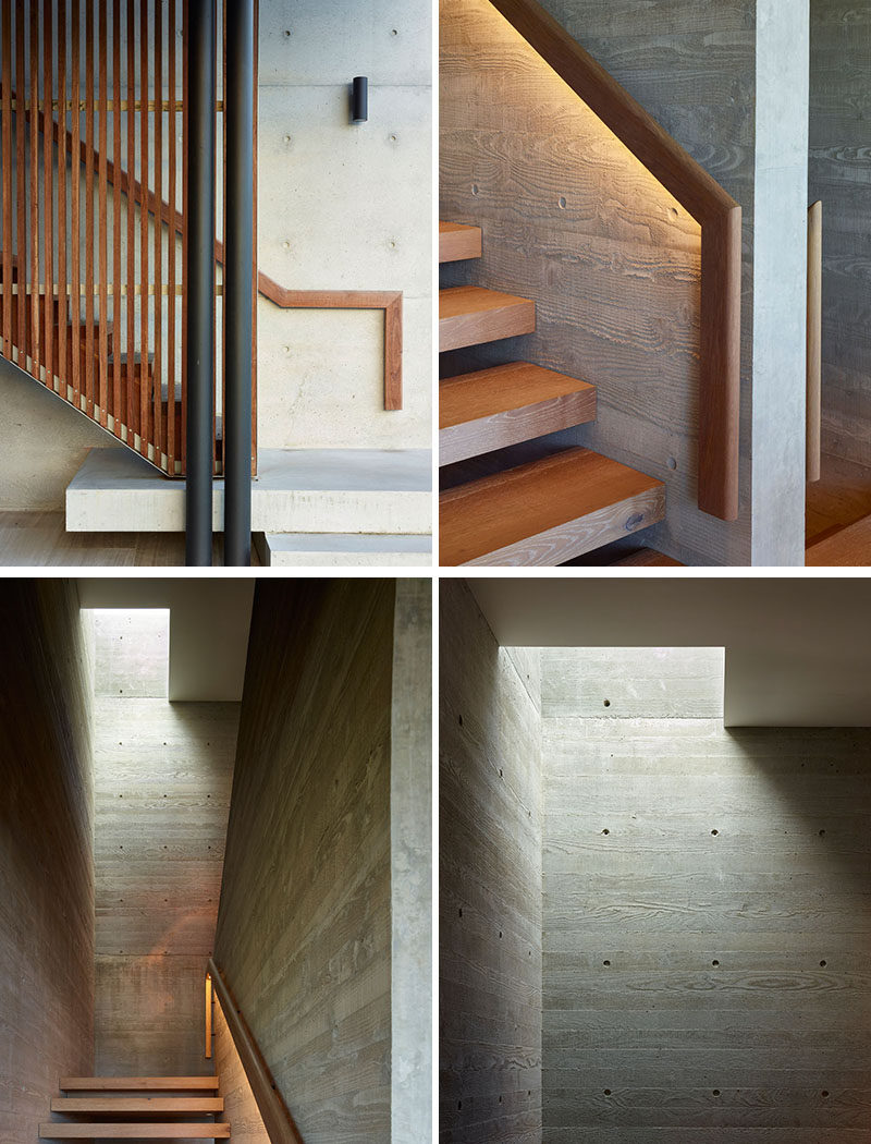 Wood stairs with a matching wood handrail connect the various floors of this modern house. At night, hidden lighting can be turned on to highlight the handrail, while board-formed concrete provides an interesting wall texture. #Stairs #Hanradil #CocnreteWalls