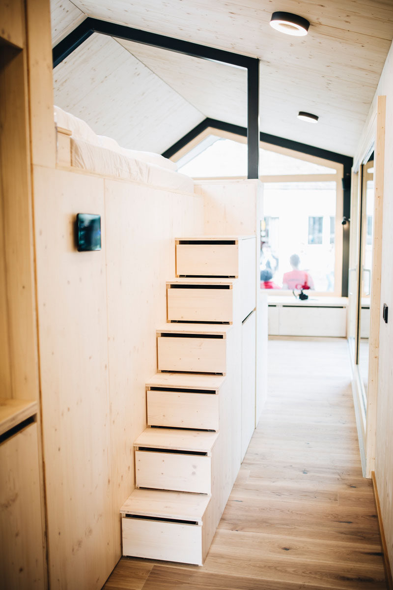 In this tiny home, the stairs leading up to the lofted bed, have built-in storage. #Stairs #StairsWithStorage #TinyHome