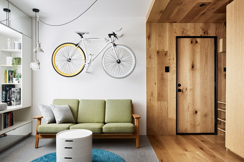 Tsai Design have transformed a small 376 square foot one bedroom apartment (35m2) in Melbourne, Australia, into a livable and functioning space, that can also operate as a home office space. #SmallApartment #LivingRoom #InteriorDesign #ModernApartment