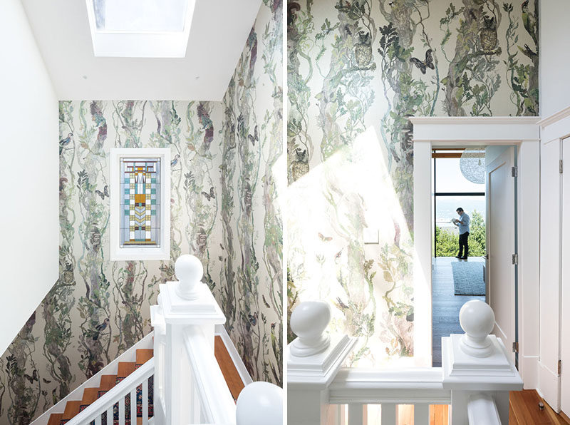 The walls surrounding these stairs are covered in a botanical patterned wallpaper, while a skylight provides ample natural light. #Wallpaper #Staircase #Skylight