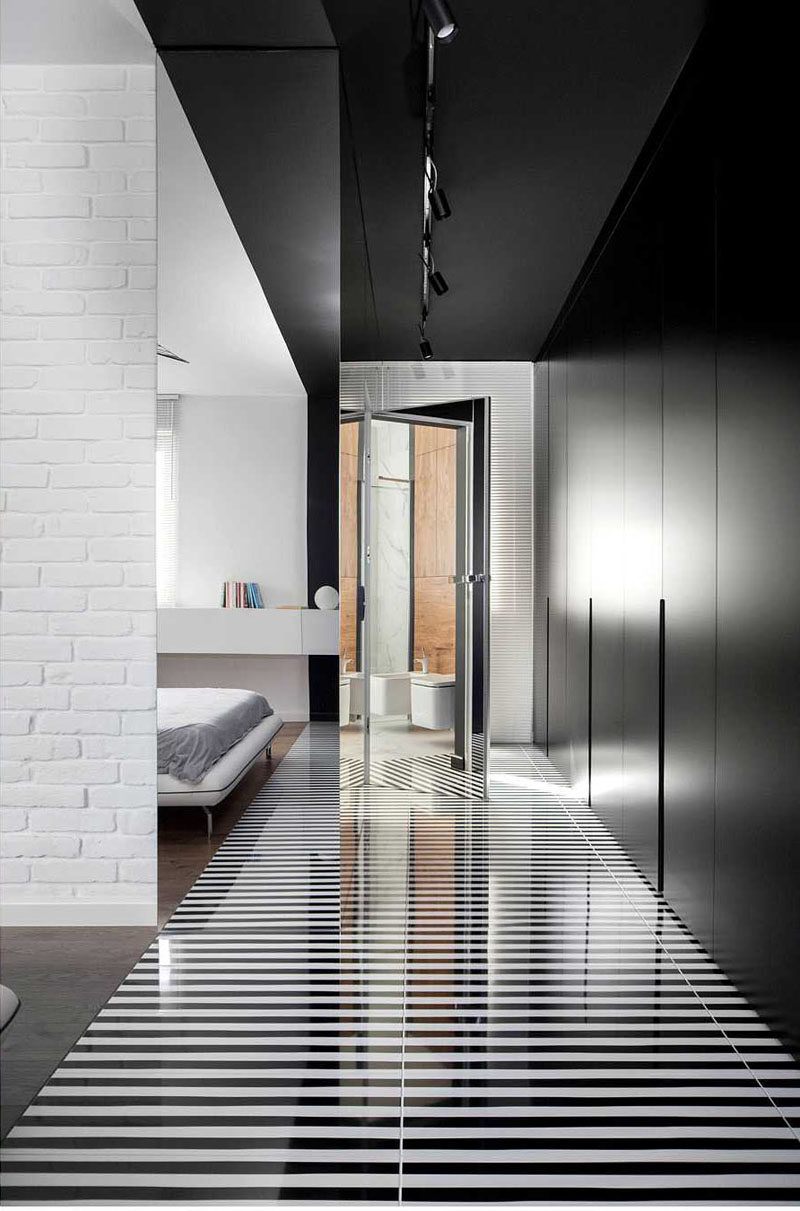 . Black And White Striped Flooring And Matte Black Closets Make A Bold
