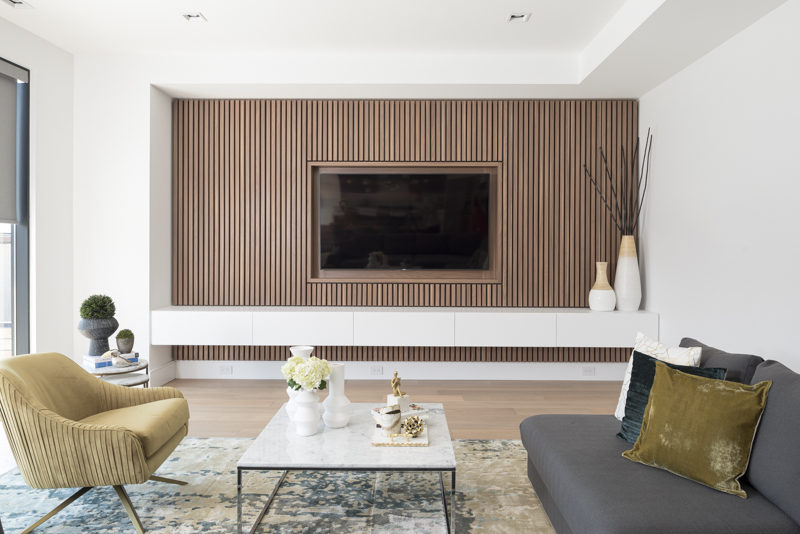 Design Detail A Wood Slat Accent Wall Surrounds The Tv In This Living Room