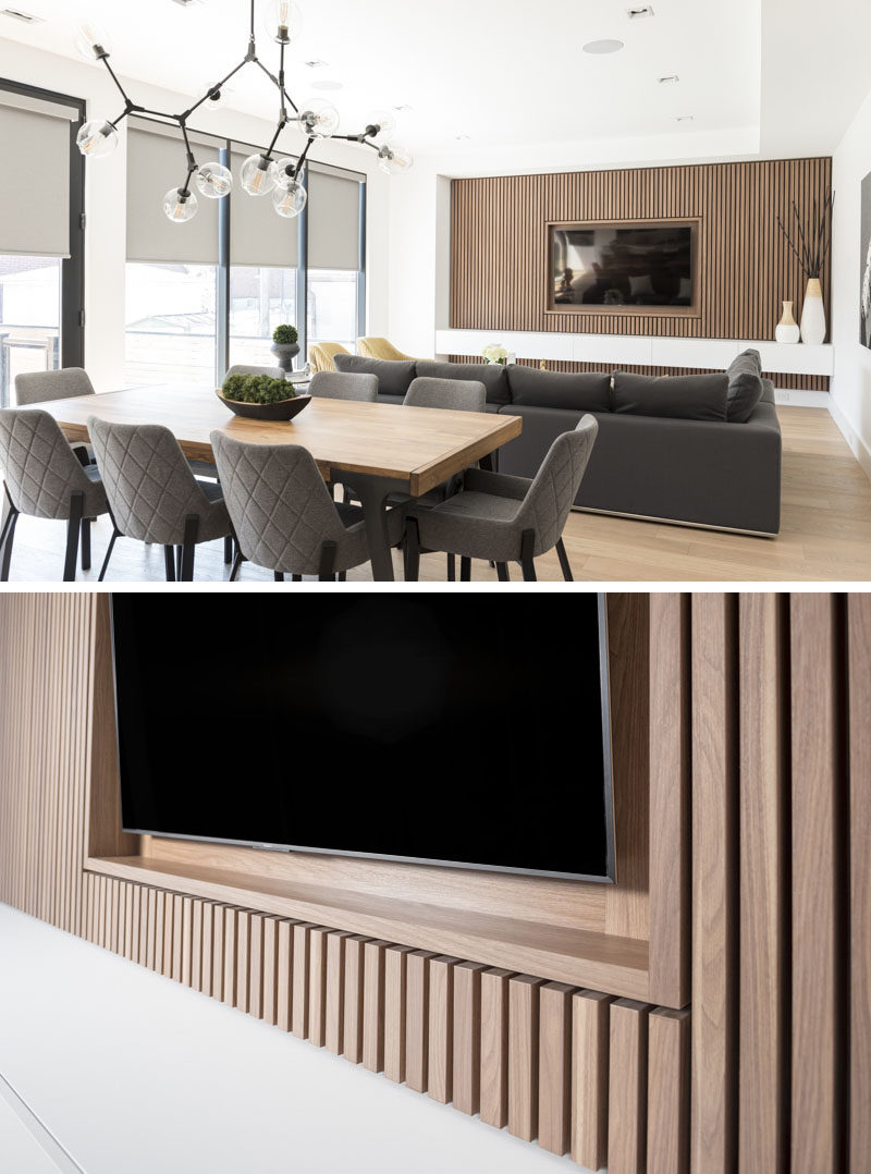 This Modern Living Room Features A Wood Slat Accent Wall That Surrounds The Tv And Provides
