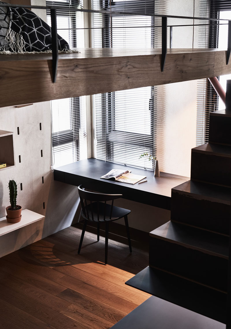 This small apartment has a desk that's positioned by the windows to take advantage of the natural light. #HomeOffice #Desk