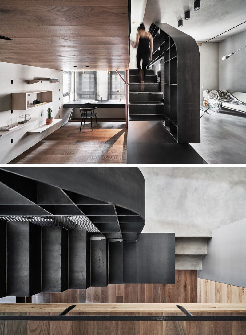 Steel stairs separate the living space and the home office of this modern apartment, and also lead up to the mezzanine. #SteelStairs #Stairs #ModernApartment