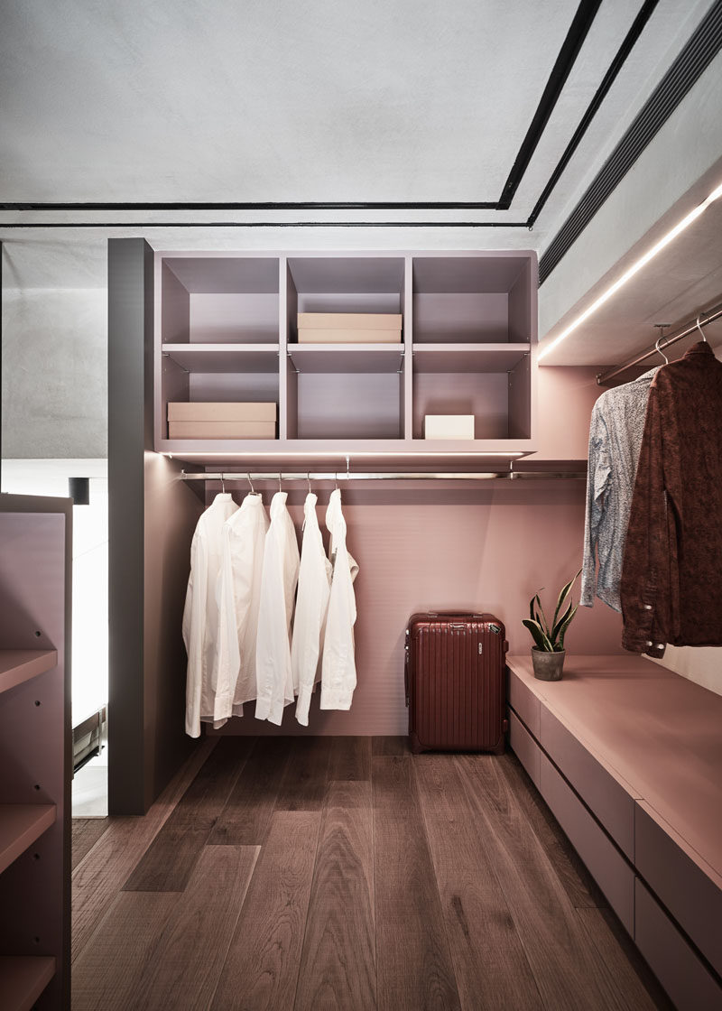 This modern bedroom features an open closet with custom shelving and built-in lighting. #Closet #OpenCloset