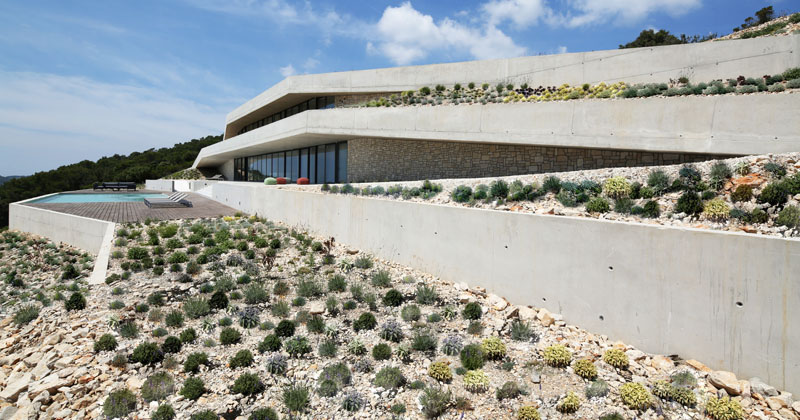 This House Almost Disappears As It's Designed To Blend Into The Landscape
