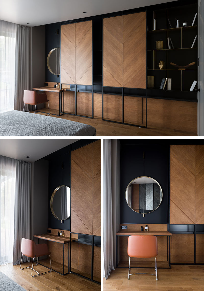 This modern bedroom has a custom shelving unit with sliding wood panels that can be opened to reveal the television, or closed to highlight the open shelving and vanity on either side. #Modernbedroom #ShelvingUnit #HideTV