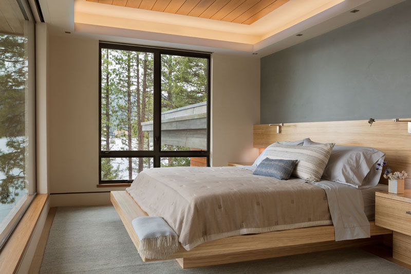 This contemporary guest bedroom has a custom-built wood bed frame to save on space. #BedroomDesign #BedFrame
