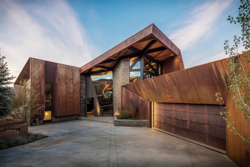 Perched on a hillside, with panoramic views of Snowmass Mountain, the Owl Creek Residence features an exterior of glass, wood, stone, and rusted steel. #Architecture #HouseDesign #ModernHouse