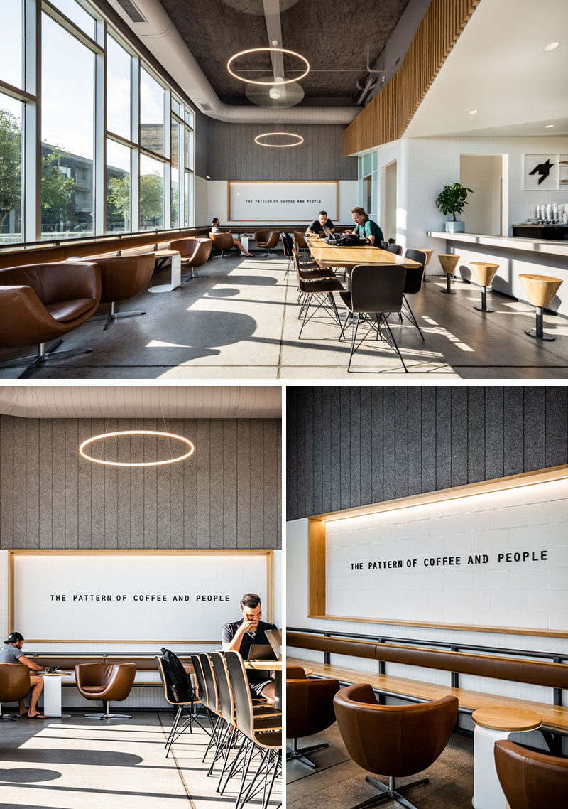Stepping inside this modern coffee shop, there's a large custom designed communal table that sits beside a row of swiveling lounge chairs and a floating bench with a leather backrest. #ModernCoffeeShop #ModernCafeDesign #InteriorDesign