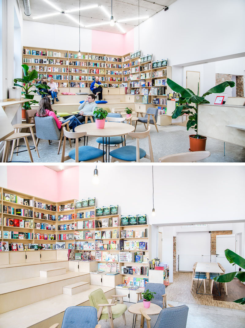 At one end of this coffee shop / bookshop is stadium seating that's surrounded by bookshelves that line the walls. The stadium seating allows customers to peruse the books and overlook the coffee shop. #StadiumSeating #CoffeeShop #TieredSeating
