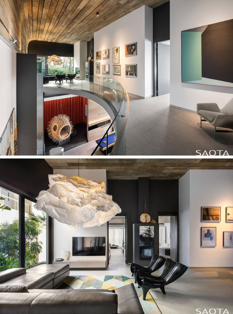 This modern house has a gallery foyer that's located on the bedroom level and has a pyjama lounge with large windows. #InteriorDesign