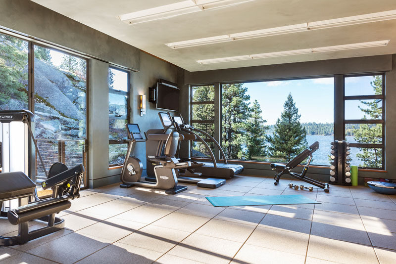 This modern house has a gym that takes advantage of the water views. #HomeGym