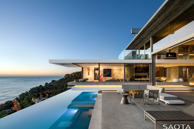 SAOTA have recently completed their latest project, a modern multi-storey house that sits perched on the shoulders of Lion's Head in Cape Town, South Africa. #ModernHouse #HouseDesign #ModernArchitecture #SwimmingPool