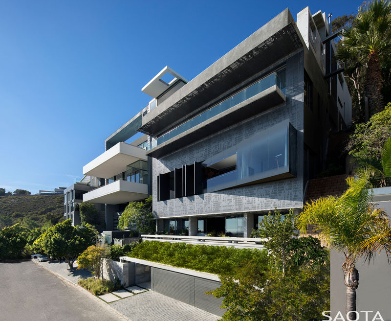 SAOTA have recently completed their latest project, a modern multi-storey house that sits perched on the shoulders of Lion's Head in Cape Town, South Africa. #ModernHouse #HouseDesign #ModernArchitecture