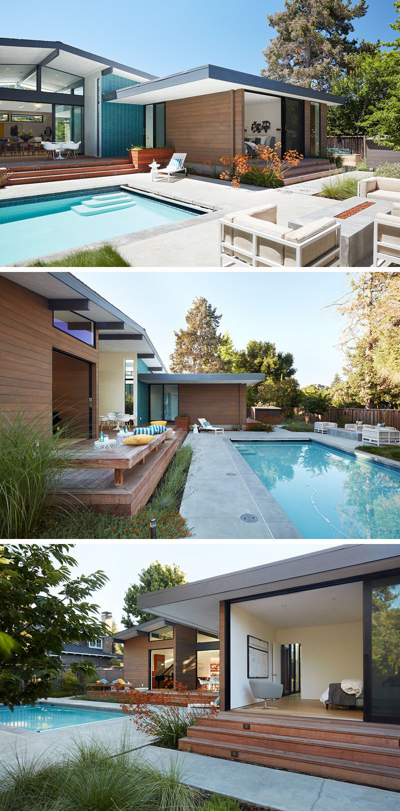 Large sliding glass panels and pocketing glass doors open this modern house to the backyard, that features a deck overlooking the pool, where the family can come together outdoors.