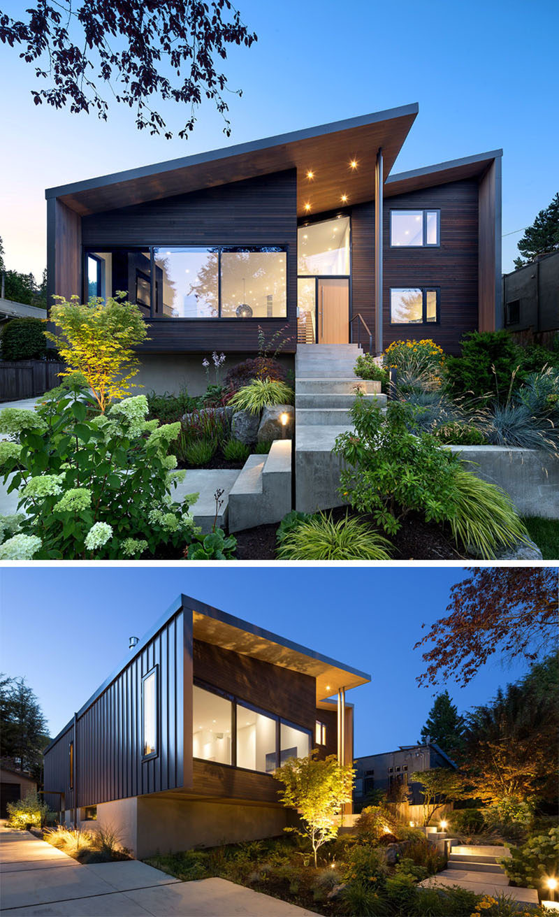 The front of this modern house benefited from new and modern landscaping that surrounding concrete steps that lead from the street to the front door. #ModernHouse #ModernLandscaping #ModernArchitecture