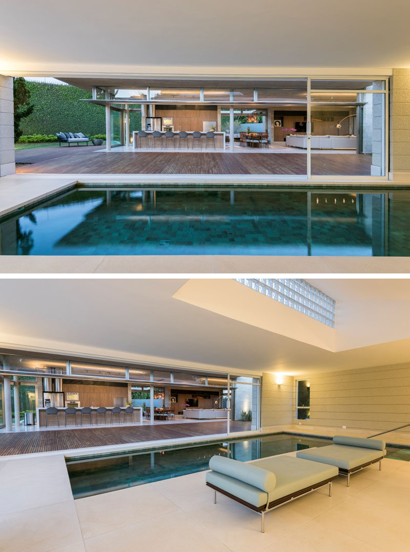Large sliding glass walls open this modern house annex completely, allowing easy movement between the interior and exterior spaces. #Annex #IndoorPool #SwimmingPool