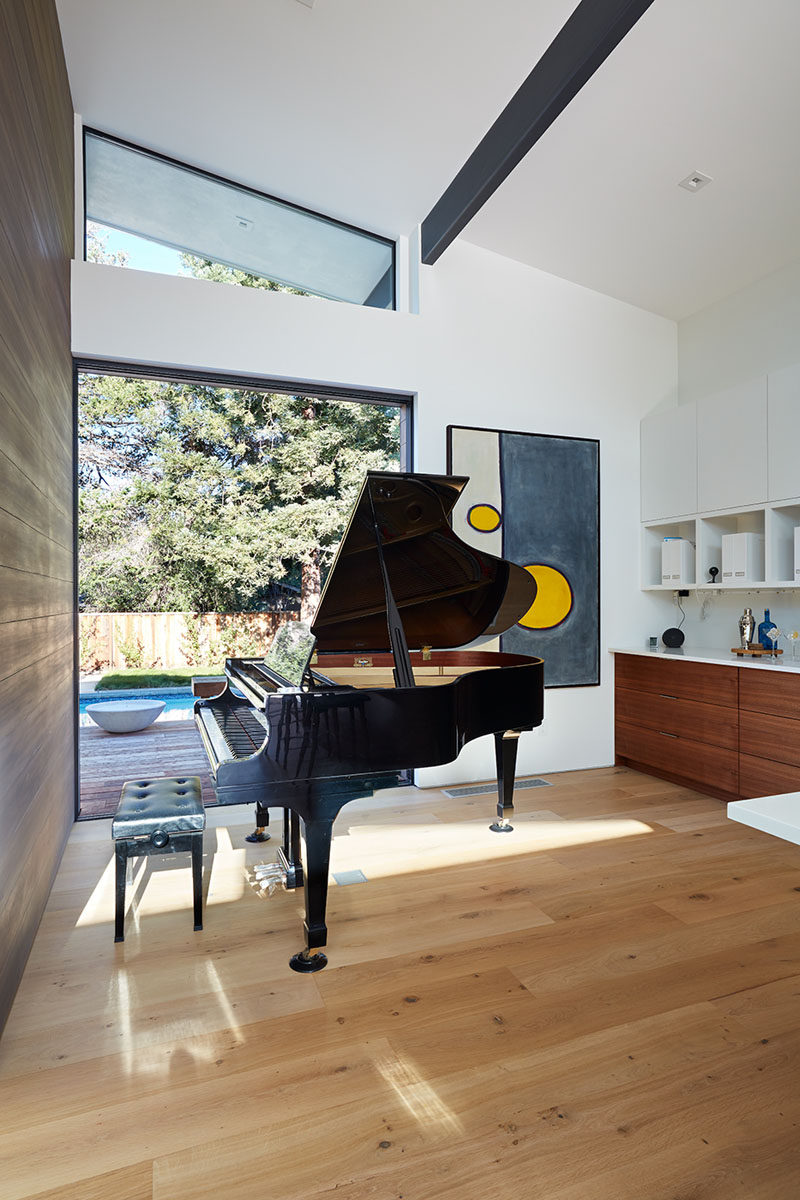 This modern house has a music room that opens to the backyard. #MusicRoom #HighCeilings