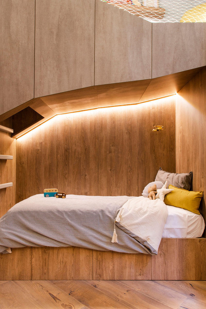 This kids bedroom has a bed built within a 'cave', creating a cozy and fun sleep environment. #KidsBedroom #KidsBed #BuiltInBed