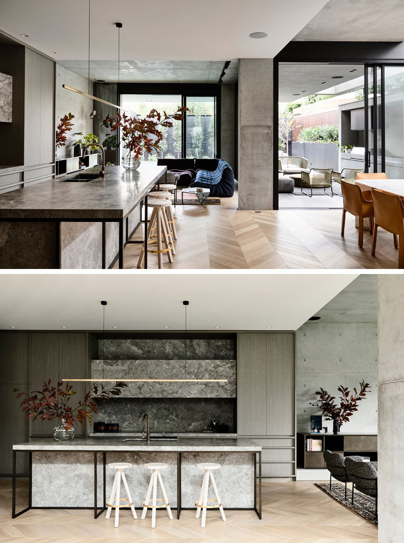 This modern house has an open floor plan, with the kitchen, dining room, and living room, all sharing the same space, and open to the backyard. #ModernKitchen #ModernInteriorDesign