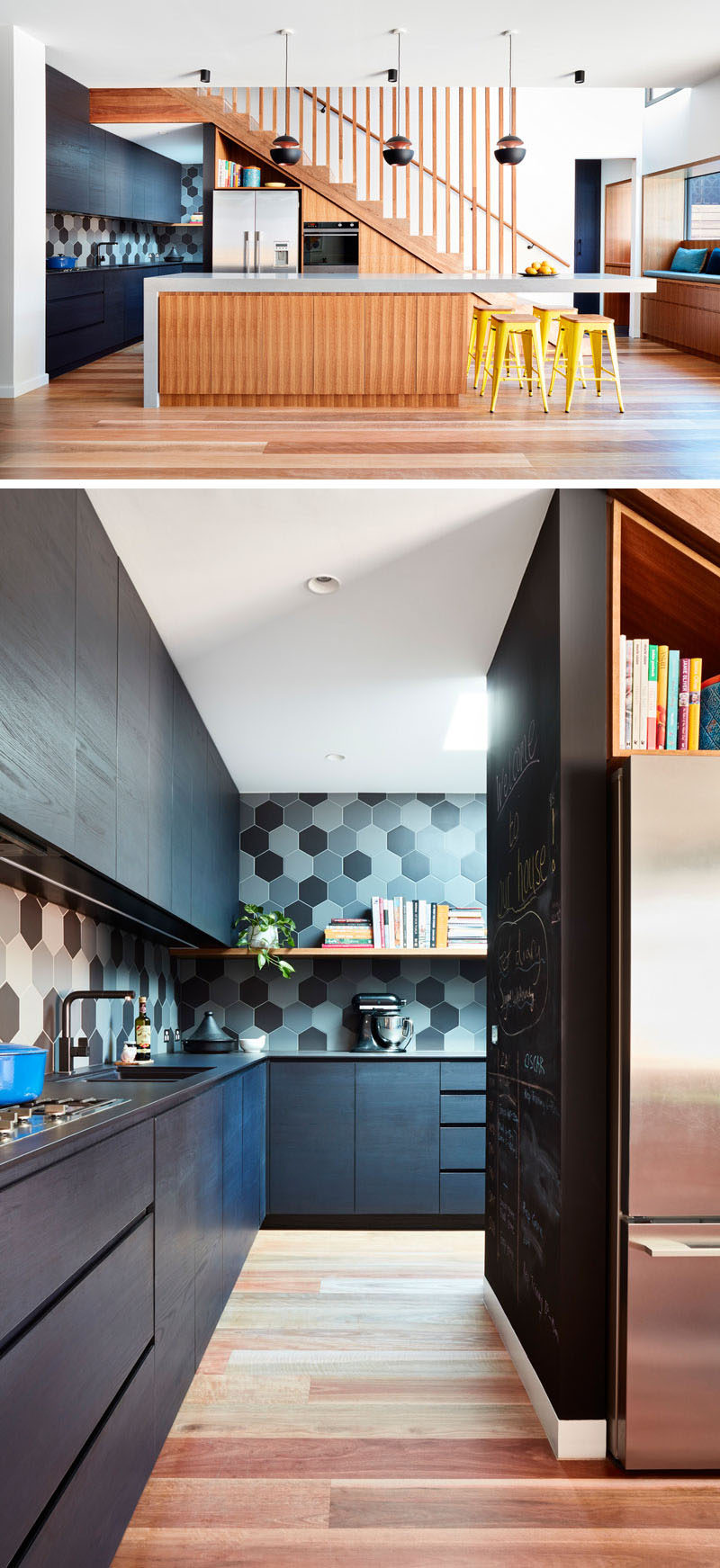 In this modern kitchen, a large island doubles as a dining area, while dark cabinets line the wall and wrap around behind the stairs. #ModernKitchen #KitchenIsland